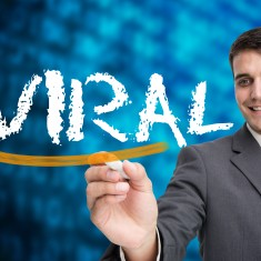 Businessman writing the word viral